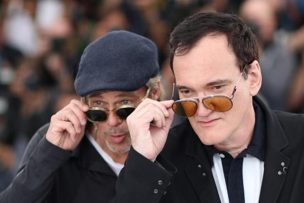 """Actor Brad Pitt (L) and US film director Quentin Tarantino pose during a photocall for the film """"Once Upon a Time... in Hollywood""""."""