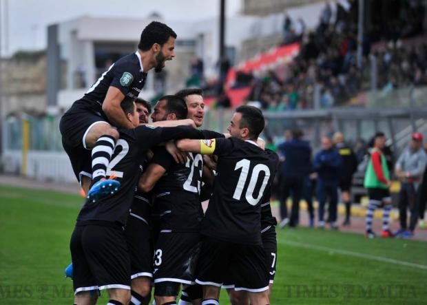 Balzan players celebrate Elkin Serrano's goal in their 2-0 win over Floriana during their Premier League football match at the Hibs Stadium in Corradino on March 5. Photo: Steve Zammit Lupi