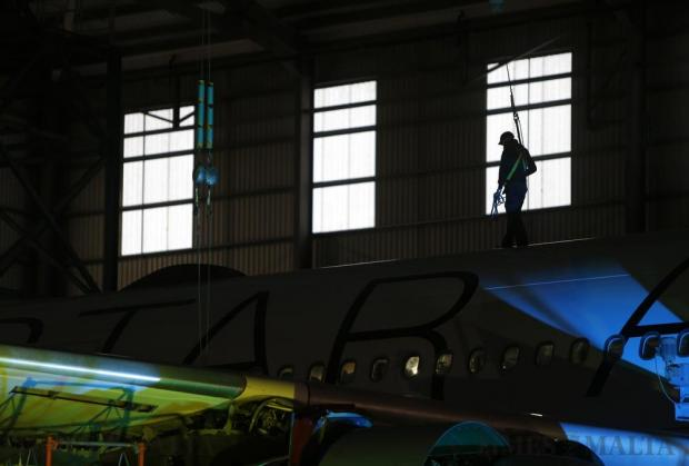 An aircraft technician walks along the fuselage of a aircraft in a Lufthansa Technik maintenance hangar at Hal-Farrug on November 23. Photo: Darrin Zammit Lupi