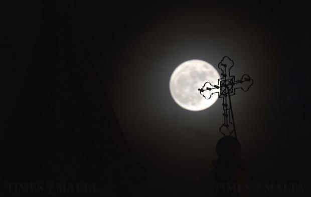 The supermoon rises behind the cross on top of Balluta church in St Julian's on November 14. Photo: Mark Zammit Cordina