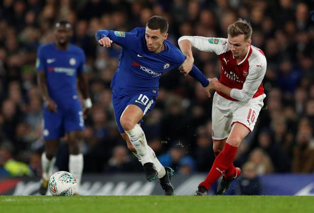 Chelsea's Eden Hazard in action with Arsenal's Rob Holding.