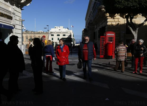 People walk in Valletta's Republic Street on a cold but sunny afternoon on January 6. Photo: Darrin Zammit Lupi