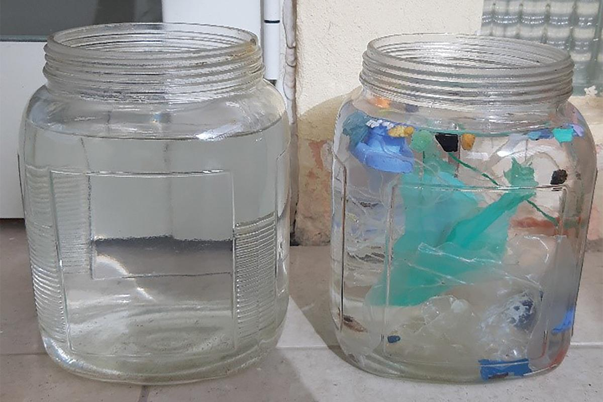 The glass jars filled with seawater.