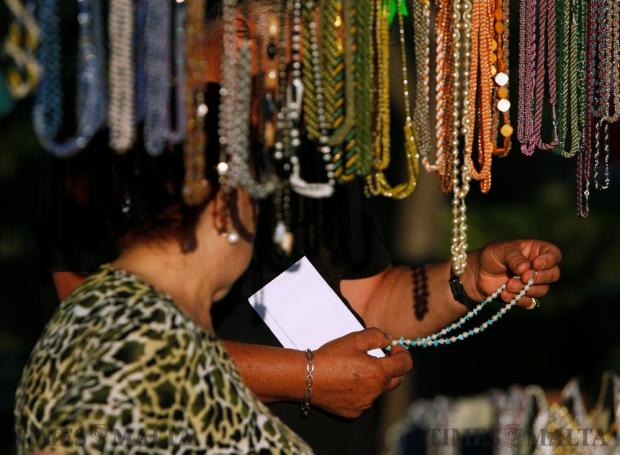 A man looks at costume jewellery at an artisan's market stall during the Ghanafest folk music festival, a showcase of Maltese folksong and international music folk fusion music, at the Argotti Gardens in Floriana on June 10. Photo: Darrin Zammit Lupi