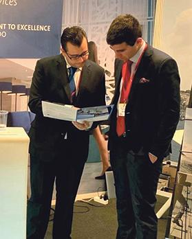 Stephen Gauci Baluci (left) on the CCFS stand at the Lantern Fund Forum.