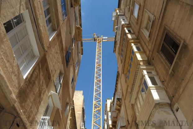 A crane blocks a narrow street in Valletta on September 22. Photo: Matthew Mirabelli
