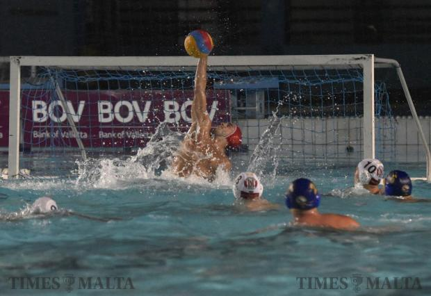 Neptunes goalkeeper Alan Borg saves the ball in the air during their waterpolo match against St Julian's at the National Pool in Tal-Qroqq on August 22. Photo: Mark Zammit Cordina