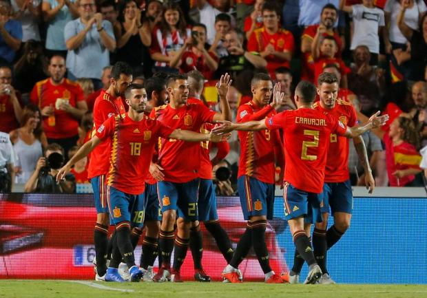 Spain's Sergio Ramos celebrates scoring their fifth goal with team mates.