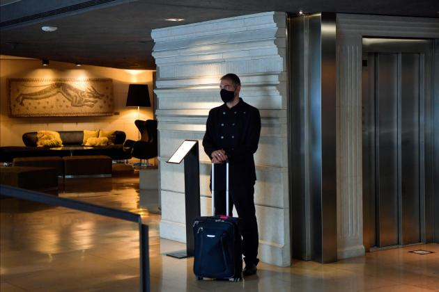 A bellboy waits for a client in the lobby of the Hotel Claris that is taking new measures against the coronavirus pandemic in Barcelona. Photos: AFP