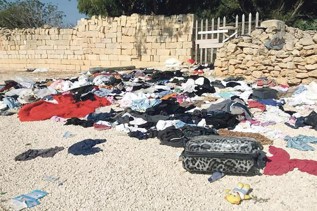 Clothes in packages, suitcases dumped at Ħal Far