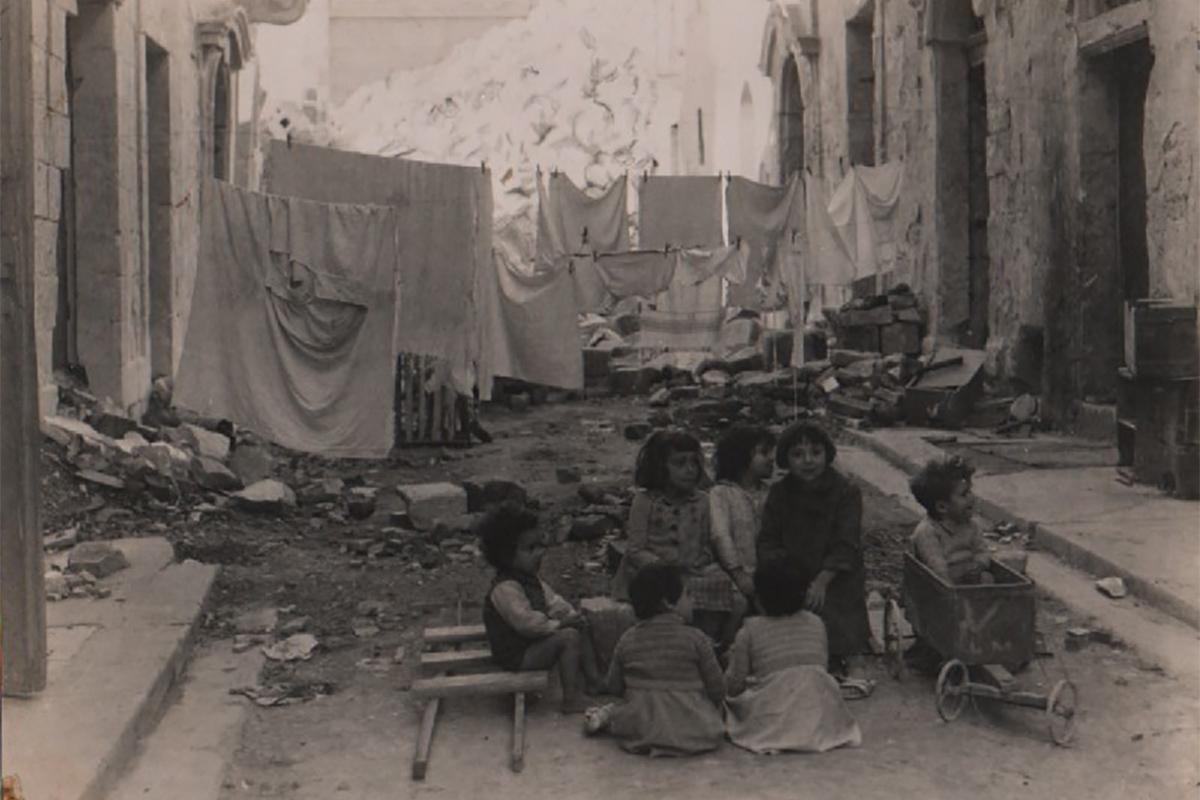 Malta's children laughing and playing amid the ruins.