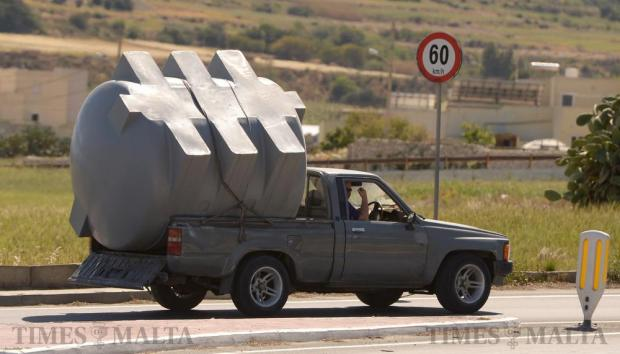 A man carries a large water tank on the back of his truck on April 11. Photo: Matthew Mirabelli