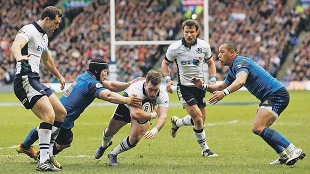 Stuart Hogg scores Scotland's first try against France in Murrayfield, yesterday.