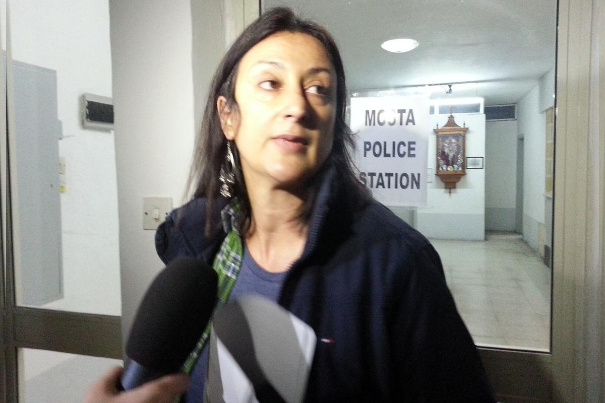 Daphne Caruana Galizia, pictured at Mosta Police Station in 2013 after being arrested for breaching the pre-election media blackout