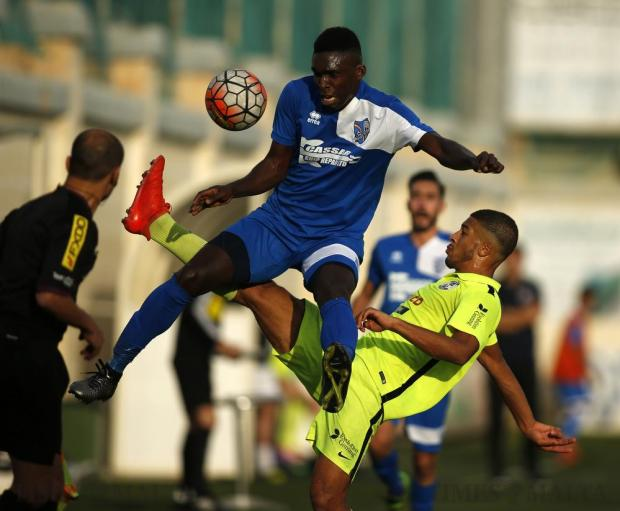 Tarxien Rainbows' Ebiabowei Baker (left) and St Andrews' Kyrian Nwoko fight for the ball during their Premier League football match at the Tedesco Stadium in Hamrun on December 3. Photo: Darrin Zammit Lupi