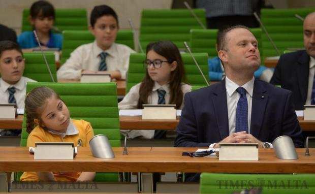 A young EkoSkola student and Prime Minister Joseph Muscat follow attentively during a special sitting in Parliament to debate a motion moved by the students urging their older peers to take action on climate change on June 2. Photo: Matthew Mirabelli