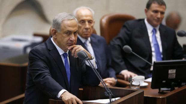 Prime Minister Netanyahu, with President Peres behind him.
