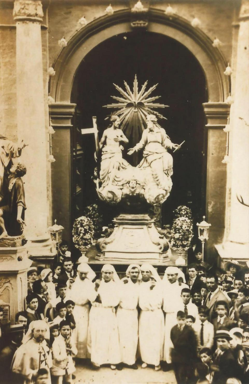 The statue of the Blessed Trinity being taken out of Senglea collegiate church as part of the 1919 procession.