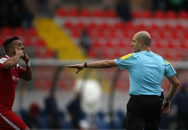 Balzan's Elkin Serrano remonstrates with referee Glen Tonna during the Premier League football match against Hibernians at the National Stadium in Ta'Qali on December 17. Photo: Darrin Zammit Lupi