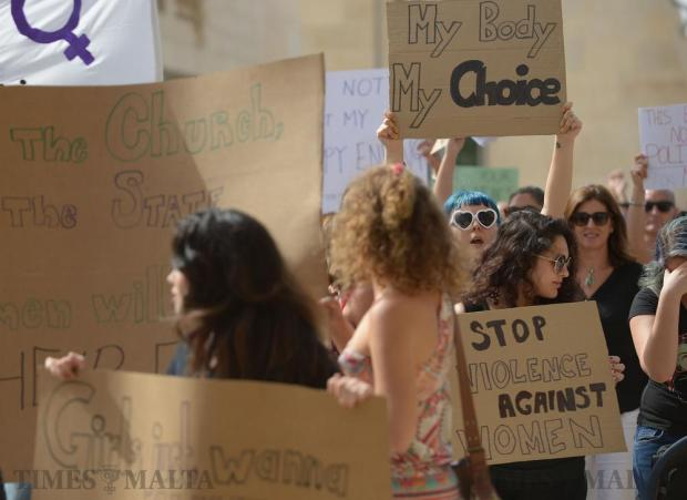 Protestors hold up banners during a march in favour of the morning-after pill being available over-the –counter in St George's Square, Valletta on October 16. Photo: Matthew Mirabelli