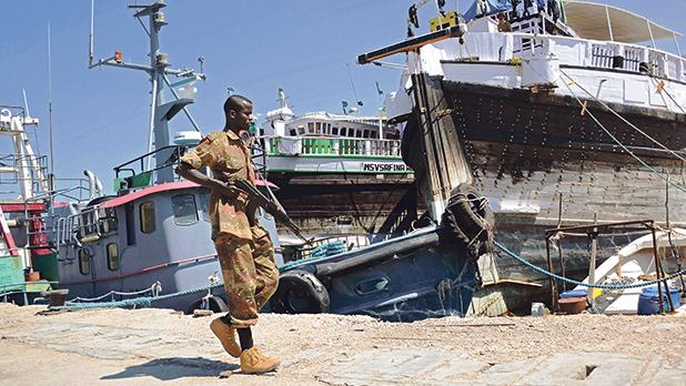 A Somali soldier walks past ships in Bosaso harbour, Puntland region, Somalia, in this file photo. Photo: AFP