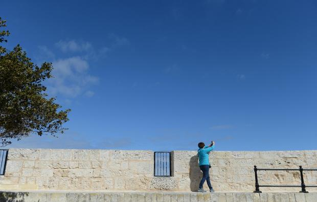 A lady takes a photo from the bastions in Mdina on March 5. Photo: Matthew Mirabelli