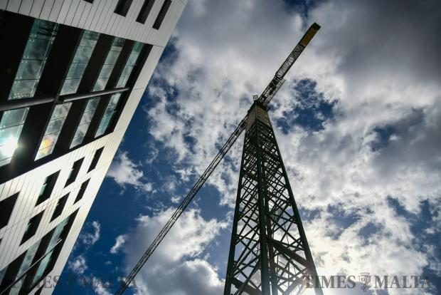 A tower crane overshadows Bay Street Complex in St Julian's on September 20. Photo : Jonathan Borg