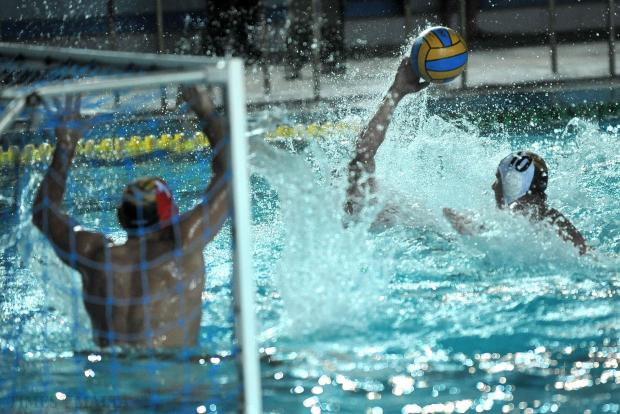 Arms and water fly during a Neptunes attack on the San Giljan goal during their match at the National Pool on August 31. Photo: Chris Sant Fournier