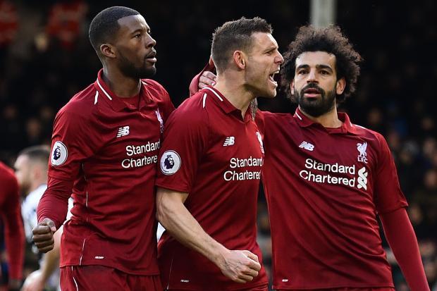 James Milner (centre) celebrates Liverpool's winner at Fulham.