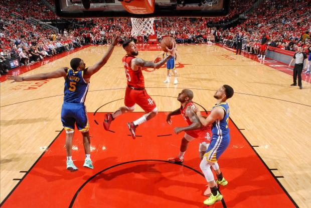 Austin Rivers (25) of the Houston Rockets goes to the basket against the Golden State Warriors.