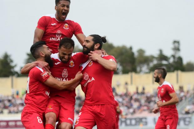 Jonathan Caruana (right) is mobbed by his team-mates after scoring Valletta's equaliser. Photo: Jonathan Borg