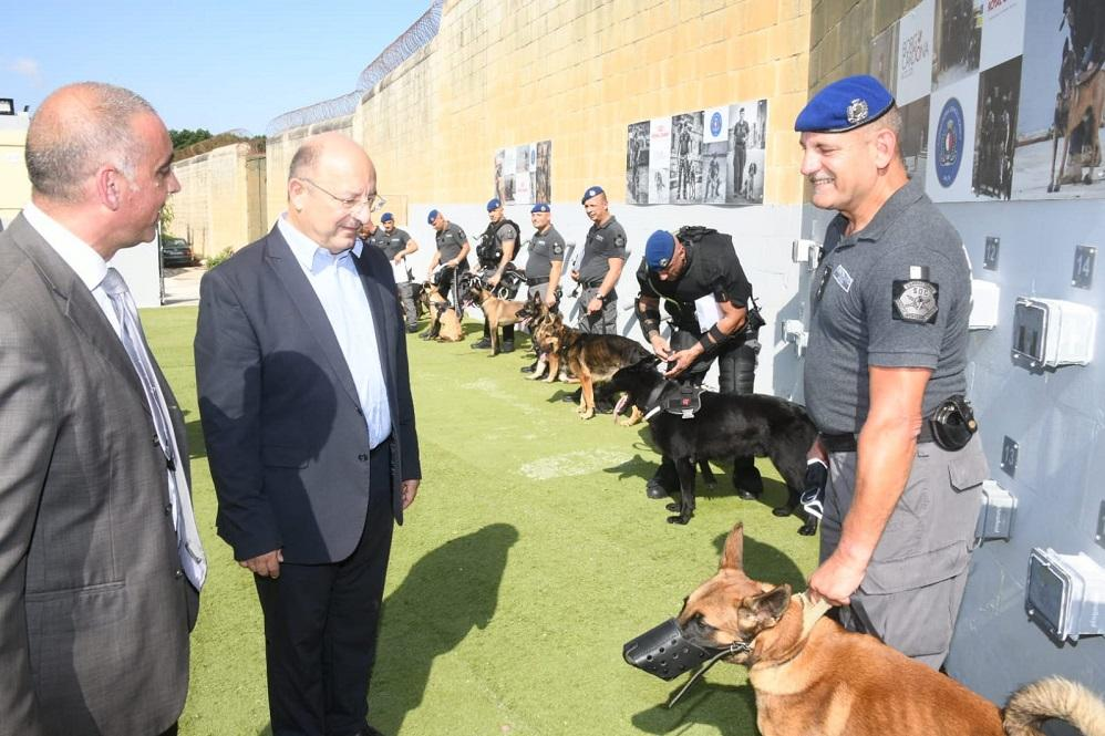 Minister Farrugia (second from right) meets and greets dogs and their handlers. Photo: DOI