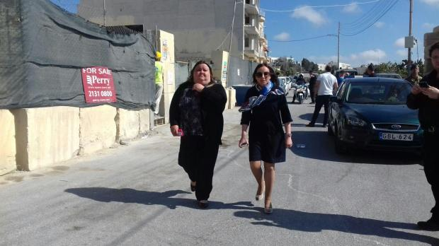 Magistrate Audrey Demicoli (right) arrives on the scene to start an inquiry.