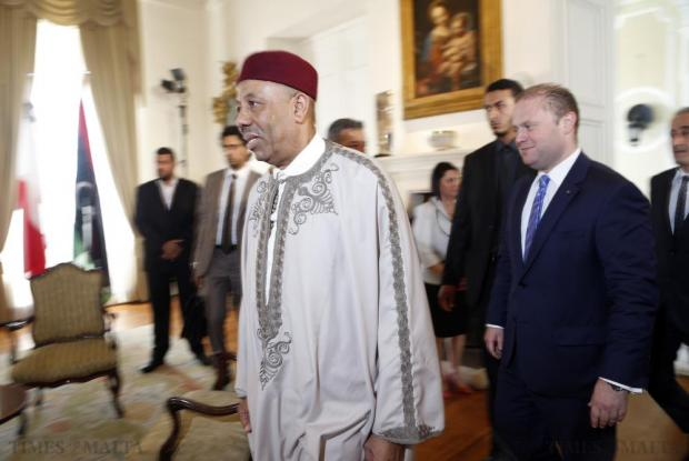 Abdullah al-Thinni (left), Prime Minister of Libya's internationally recognised government, arrives for talks with Maltese Prime Minister Joseph Muscat (right) at the Auberge de Castille in Valletta on July 1. Photo: Darrin Zammit Lupi