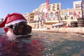 Watch: Scuba diving Santa picks up waste from Spinola seafloor