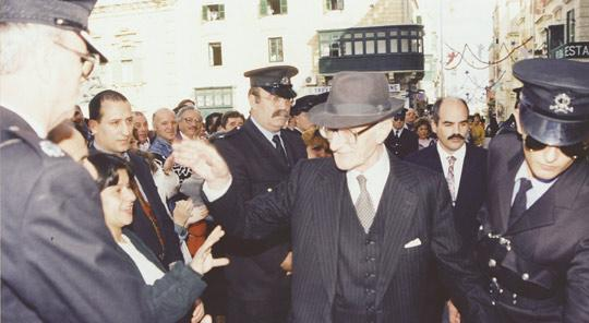 Sir Anthony walking along Republic Street in Valletta after the opening of Parliament in December 1996.