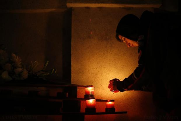 A man lights a candle to place beneath a shrine on the hill leading up to Laferla Cross outside Siggiewi on April 2. Every year on Maundy Thursday, thousands of religious devotees make their way up the hill, the highest point on the Maltese islands, on a Seven Churches Visitation pilgrimage. Photo: Darrin Zammit Lupi