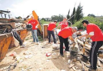 HSBC staff clearing rubble at the Dar Frate Jacoba in Marsascala.