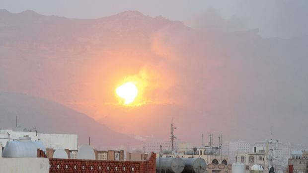 An explosion is seen from the rooftops of Yemen's capital, Sanaa, during an air strike by the Saudi coalition.