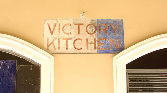 The Victory Kitchen sign, protected by the planning authority, is being restored and will be lit up at night.