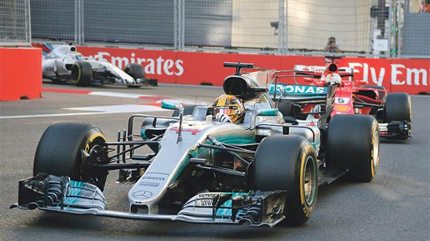 Mercedes driver Lewis Hamilton leads Sebastian Vettel, of Ferrari, during Sunday's Azerbaijan Grand Prix.