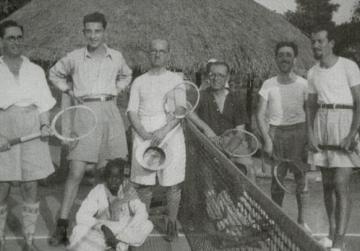 Enjoying a game of tennis.
