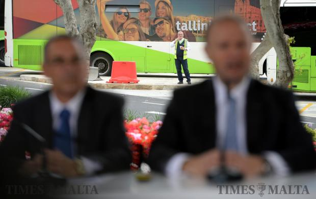 A man smokes a cigarette whilst a press conference by Prime Minister Joseph Muscat takes place in Floriana on May 11. Photo: Matthew Mirabelli