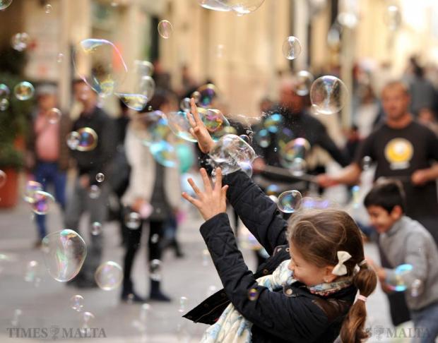 A girl bursts soap bubbles in Republic Street in Valletta on November 29. Photo: Chris Sant Fournier