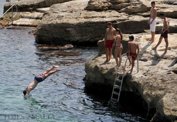 A man dives into the sea at Qui-Si-Sana in Sliema on August 31. Photo: Chris Sant Fournier