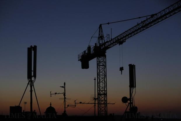 Mobile phone antennae and a crane are seen at dusk in Valletta on June 7. Photo: Darrin Zammit Lupi