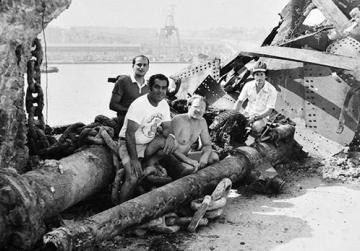 David Schembri (third from left) with some of the hauled wreckage.