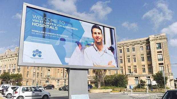 A Vitals Global Healthcare billboard promoting the contract in 2017.