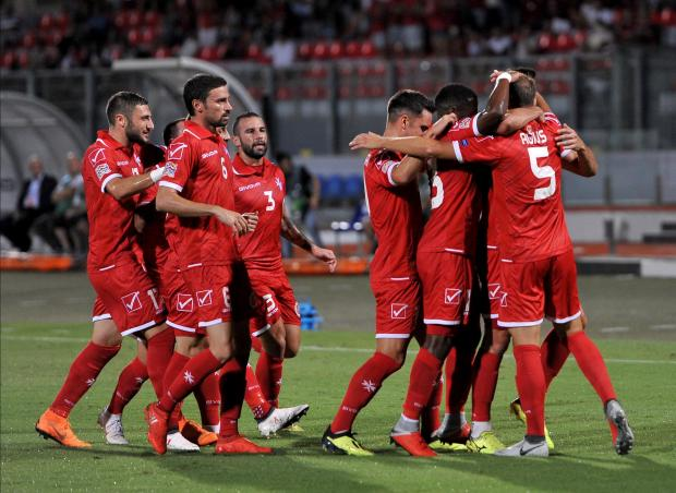 Malta players celebrating after Andrei Agius' converted penalty. Photo: Chris Sant Fournier