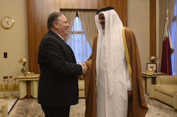 Mr Pompeo shakes hands with Qatar's Emir, during a trip to Doha. Photo: AFP